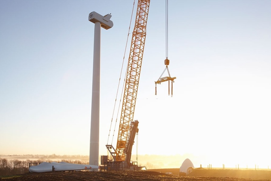 crawler crane during sunset